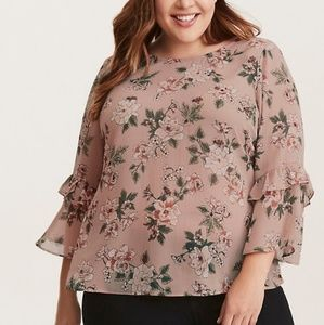 Torrid floral blouse with ruffles.